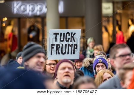 Trump demonstration. Stockholm Sweden - January 21 2017: Close up image of protests selective focus of people and sign with pun words during demonstration on public square in the center of Stockholm.