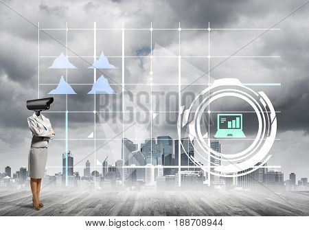 Businesswoman with camera instead of head and media user interface on screen