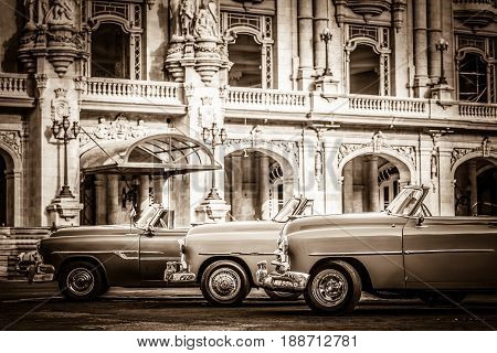 Havana, Cuba - July 05, 2015: HDR - Street life with parked american convertible vintage cars before the gran teatro in Havana Cuba - Retro Serie SEPIA Cuba Reportage