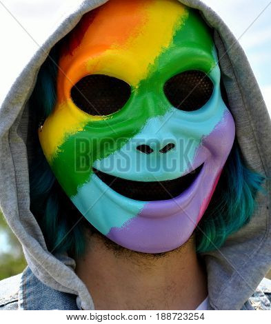 Gay, lesbian pride day rainbow colors face mask worn by a male.