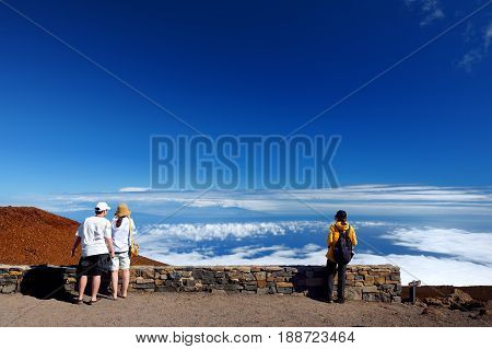Tourists Admiring Stunning Landscape View Of Haleakala Volcano Area From The Summit. Maui, Hawaii,