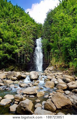 Beautiful View Of A Waterfall Located Along Famous Road To Hana On Maui Island, Hawaii