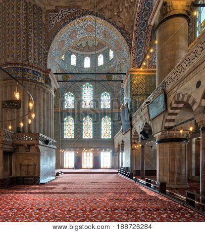 Istanbul, Turkey - April 16, 2017: Interior of Sultan Ahmed Mosque (Blue Mosque) with a huge pillars arches and colored stained glass windows Istanbul Turkey