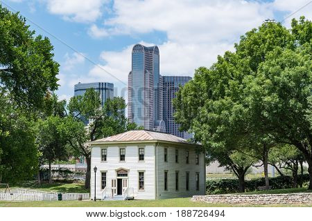 DALLAS, TX - MAY13, 2017: Historic Renner School building in the Dallas Heritage Village with the Dallas city skyline in background.