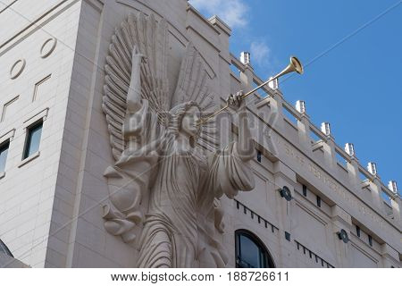 FORT WORTH, TX - MAY 12, 2017: Trumpeting Angel sculpture on the facade of Bass Performance Hall in Fort Worth, Texas