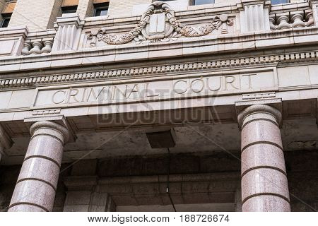 Criminal Court sign on front facade of courthouse building