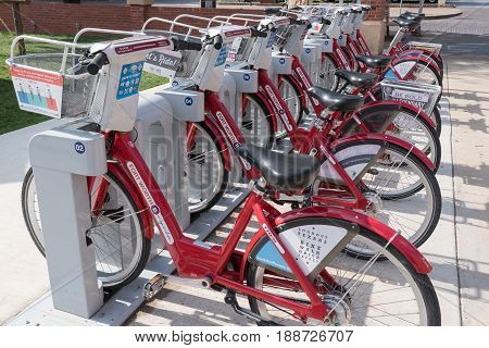 FORT WORTH, TX - MAY 11: Red bicycles lined up at Fort Worth Texas Bike Share Station.