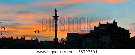 Sunset in Warsaw Old Town. Panoramic wide angle view.