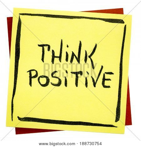 Think positive inspirational reminder - handwriting on an isolated sticky note