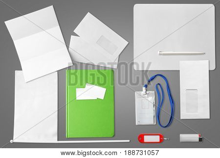Concept of brand promotion and marketing. Different products with space for logo, label or text on gray background