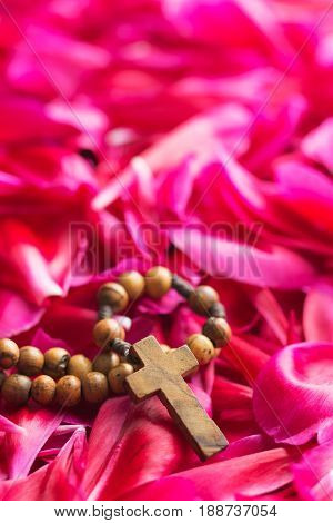 Rosary beads on flower background. Pray concept.
