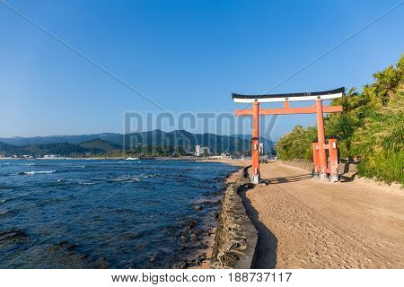 Red torii in Aoshima Shrine with blue sky
