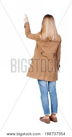 Back view of  pointing womanin brown cloak. beautiful brunette  girl. Rear view people collection.  backside view of person.  Isolated over white background.