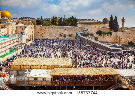 The huge crowd of Jews for a prayer has gathered on the square. Western Wall of the Temple. Autumn holiday of Sukkot in Jerusalem.