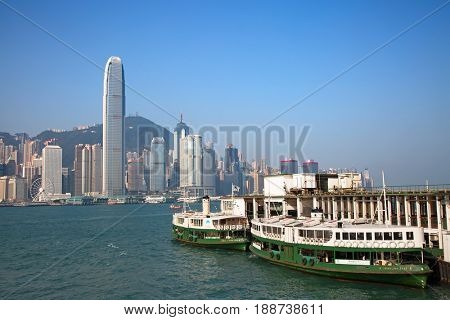 HONG KONG - APRIL 2: Ferries docked at pier on April 2, 2017 in Hong Kong, China. Hong Kong ferry is in operation for more than 120 years and is one of main attractions of the city.