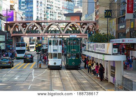 HONG KONG - APRIL 02: Unidentified people using tram in Hong Kong on April 02, 2017. Hong Kong tram is the only in the world run with double deckers and one of the main tourist attractions.