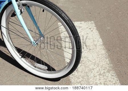 Bicycle wheel on zebra crossing, outdoor