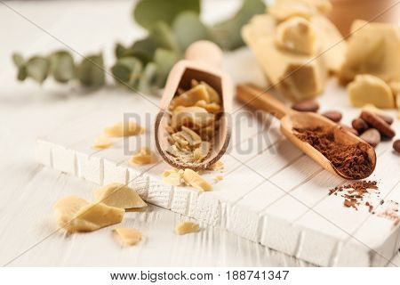 Cocoa butter and powder on wooden board
