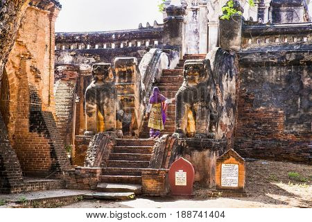 BAGAN, MYANMAR - MARCH 9, 2017. An unidentified woman at ancient city in Bagan (Pagan) on March 9, 2017, Myanmar.