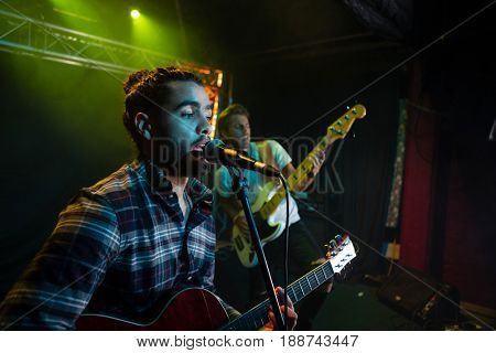 Band performing on stage in nightclub