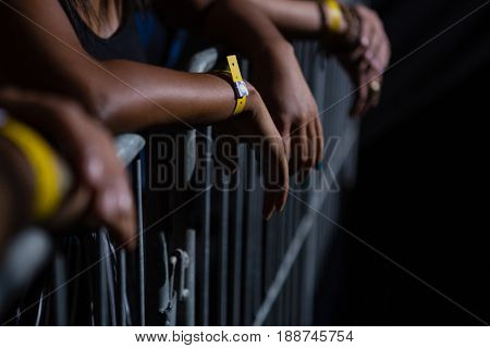 Group of friends watching a rock concert in club