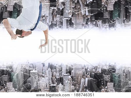 Digital composite of up side down city. men on the up city trying touch the down city
