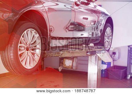 Car on hoist at repair shop