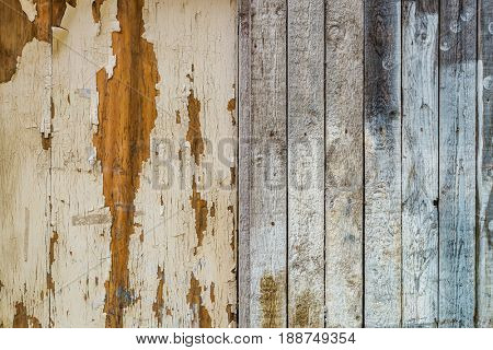 Old weathered distressed wood background texture with peeling paint and stained upright planks for rustic design themes