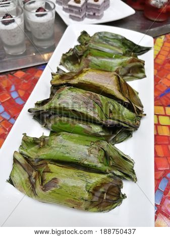 Malaysia cuisine, grilled glutanous rice in banana leaves