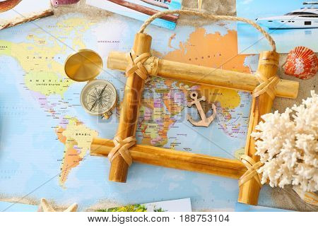 Travel concept. Composition with bamboo frame on world map background