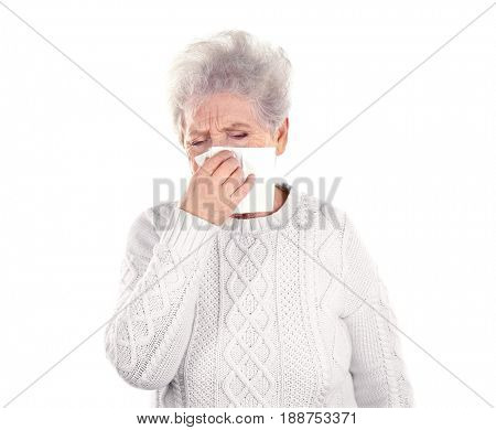 Mature ill woman with tissue, isolated on white. Concept of allergy