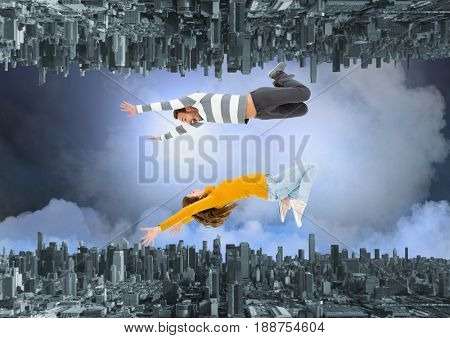 Digital composite of up side down city. jump to meet the other