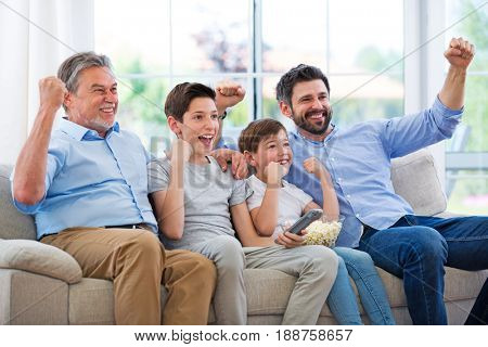 Family of three generations watching tv