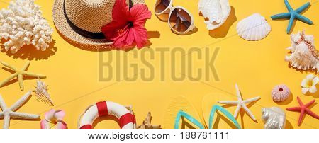 Straw hat, sun glasses and seashells