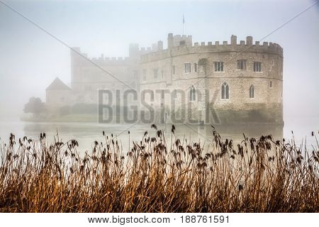 foggy autumn day at Leeds castle and moat
