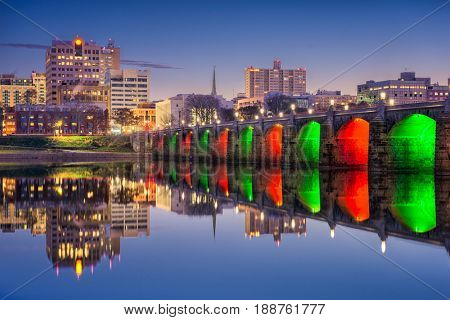 Harrisburg, Pennsylvania, USA skyline on the Susquehanna River with holiday lighting.