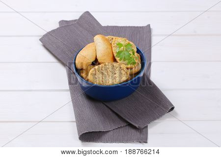bowl of crispy rusks on grey place mat