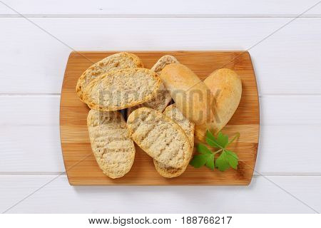 pile of crispy rusks on wooden cutting board