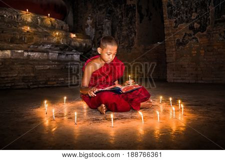 BAGAN, MYANMAR-MARCH 9, 2017: Young Buddhist novice monks learning Buddhist teaching inside monastery in Bagan on March 9, 2017, Myanmar. (Burma)