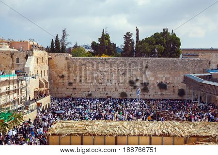 At Temple Square was a huge crowd of Jews. The Western Wall of the Temple. Autumn holiday of Sukkot in Jerusalem