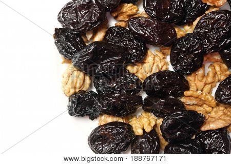 Nuts and prunes. Delicious walnuts with black plum