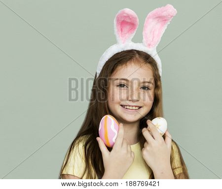 Children with bunny hairband and easter eggs
