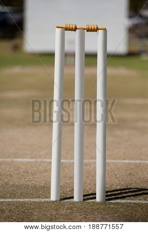White stumps on cricket field during sunny day