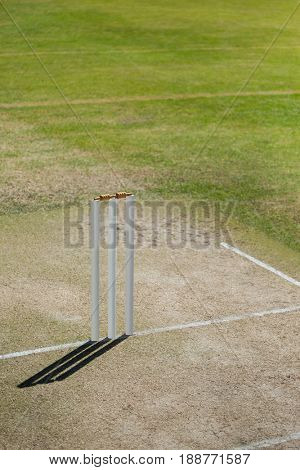 High angle view of stumps on cricket field during sunny day