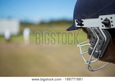 Close up of batsman at field on sunny day