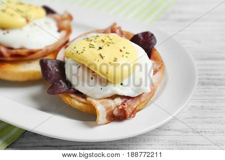Tasty eggs Benedict with avocado on plate