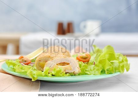 Delicious Cordon Bleu chicken on plate