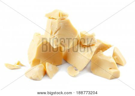 Pieces of cocoa butter on white background