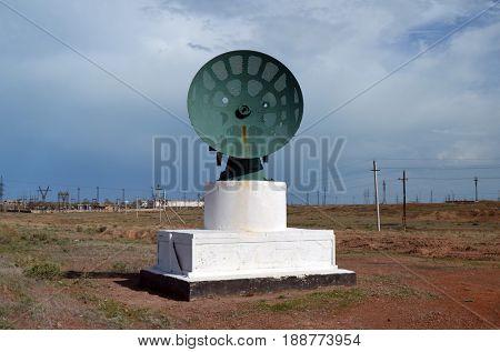 Road decoration. Vintage radar antenna.Former Soviet anti-ballistic missile testing range Sary Shagan.May 6, 2017.Priozersk.Kazakhstan