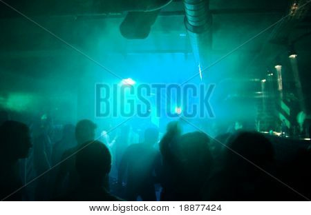 silhouettes of people on disco party in green light